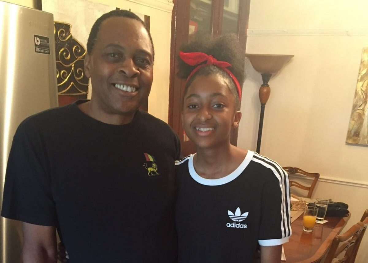 Ashleigh standing next to her dad, both smiling