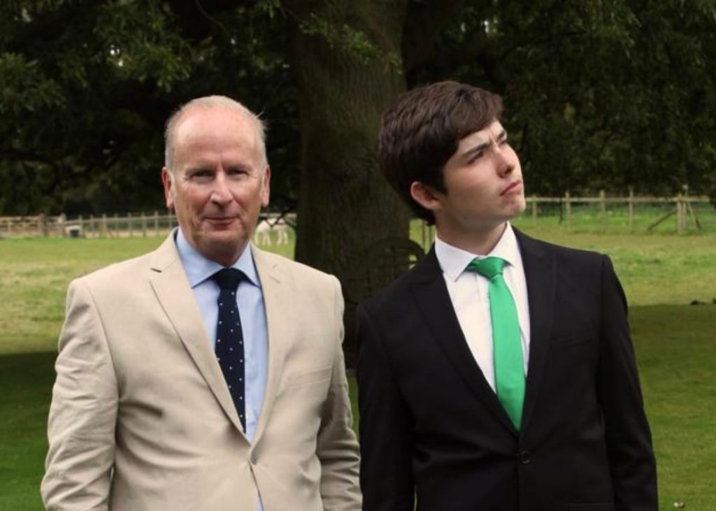 Conor and his dad dressed in suits