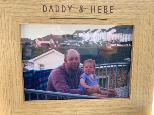 Hebe as a baby with her dad in a wooden frame with Daddy & Hebe written on